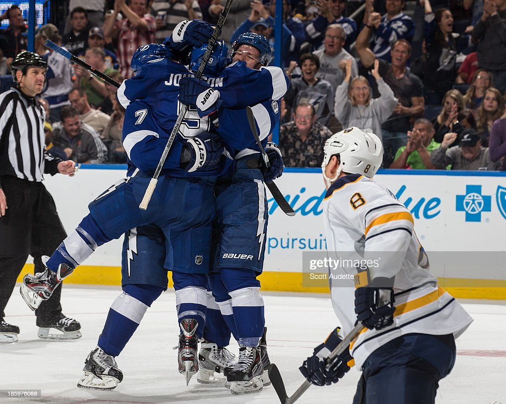 Ondrej Palat #18 of the Tampa Bay Lightning celebrates his goal with teammates <a gi-track='captionPersonalityLinkClicked' href=/galleries/search?phrase=Radko+Gudas&family=editorial&specificpeople=5648763 ng-click='$event.stopPropagation()'>Radko Gudas</a> #7 and <a gi-track='captionPersonalityLinkClicked' href=/galleries/search?phrase=Tyler+Johnson+-+Ice+Hockey+Player&family=editorial&specificpeople=14574766 ng-click='$event.stopPropagation()'>Tyler Johnson</a> #9 during the third period against the Buffalo Sabres at the Tampa Bay Times Forum on October 26, 2013 in Tampa, Florida.