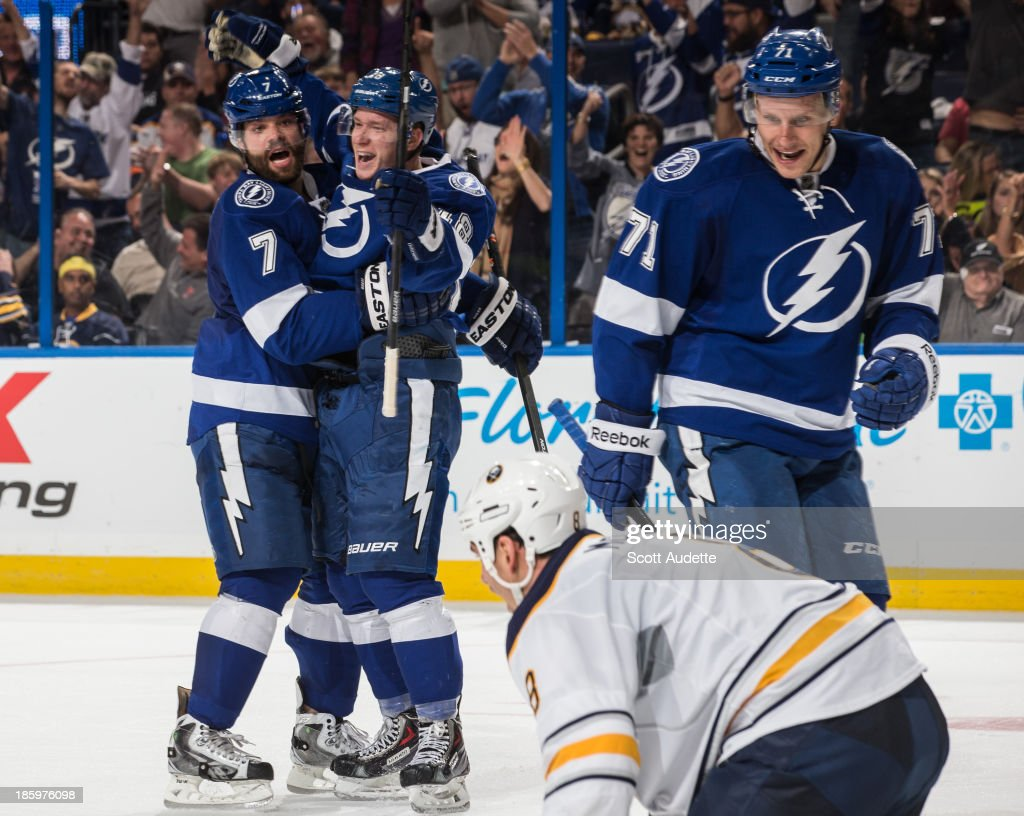 Ondrej Palat #18 of the Tampa Bay Lightning celebrates his goal with teammate <a gi-track='captionPersonalityLinkClicked' href=/galleries/search?phrase=Radko+Gudas&family=editorial&specificpeople=5648763 ng-click='$event.stopPropagation()'>Radko Gudas</a> #7 during the third period against the Buffalo Sabres at the Tampa Bay Times Forum on October 26, 2013 in Tampa, Florida.