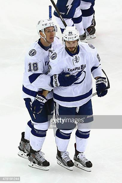 Ondrej Palat of the Tampa Bay Lightning celebrates with his teammate Nikita Kucherov after scoring a goal against Henrik Lundqvist of the New York...