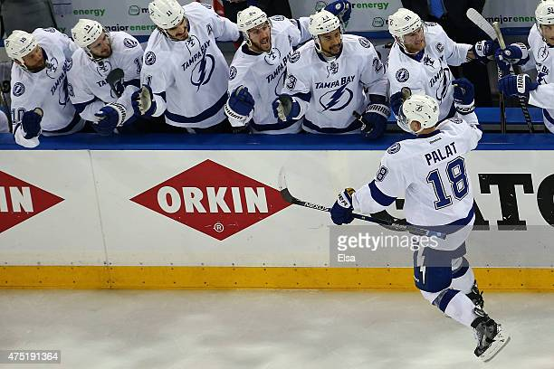 Ondrej Palat of the Tampa Bay Lightning celebrates with his teammates after scoring a goal against Henrik Lundqvist of the New York Rangers during...