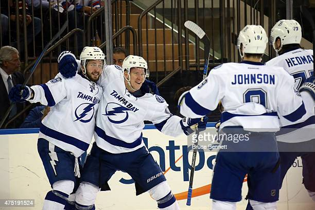Ondrej Palat of the Tampa Bay Lightning celebrates with his teammates Ondrej Palat Tyler Johnson and Victor Hedman after scoring a goal against...