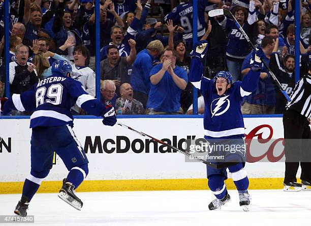 Ondrej Palat of the Tampa Bay Lightning celebrates with teammate Nikita Nesterov after scoring a goal in the third period against Henrik Lundqvist of...