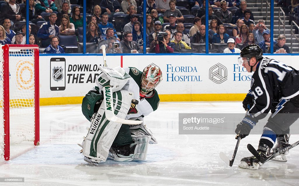 Ondrej Palat of the Tampa Bay Lightning has his shot saved by goalie Darcy Kuemper of the Minnesota Wild during the third period at the Amalie Arena...