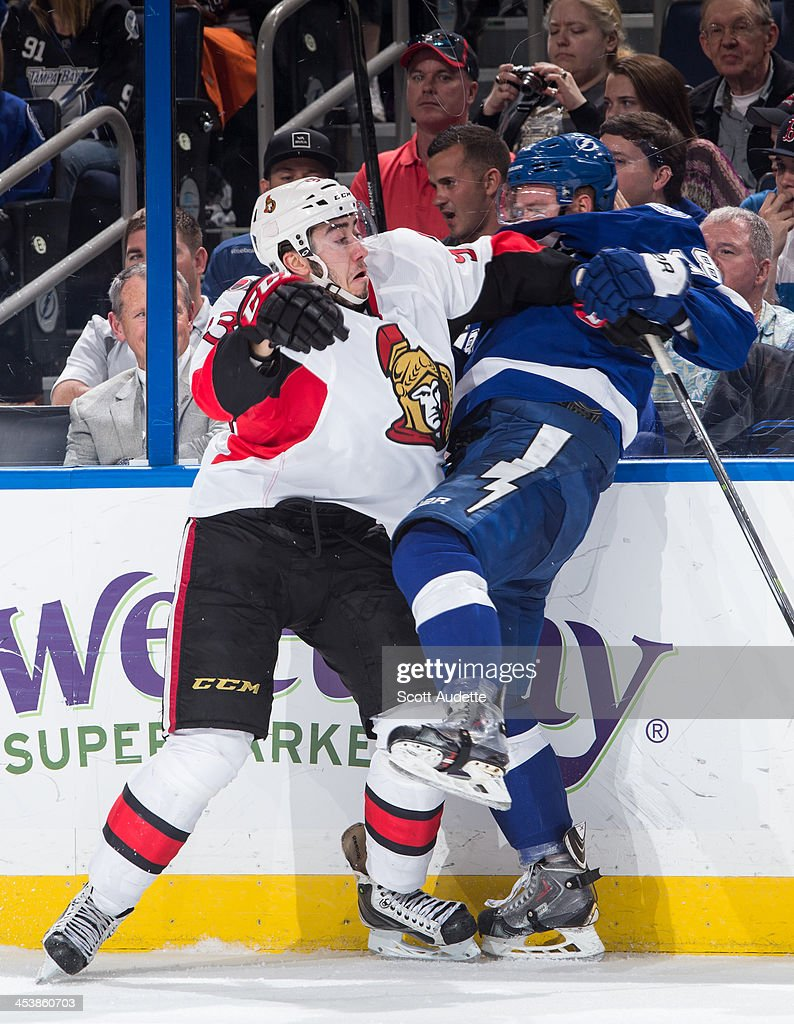 Ondrej Palat #18 of the Tampa Bay Lightning is checked by <a gi-track='captionPersonalityLinkClicked' href=/galleries/search?phrase=Mika+Zibanejad&family=editorial&specificpeople=7832310 ng-click='$event.stopPropagation()'>Mika Zibanejad</a> #93 of the Ottawa Senators during the third period at the Tampa Bay Times Forum on December 5, 2013 in Tampa, Florida.