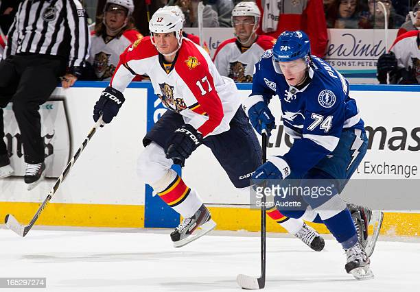Ondrej Palat of the Tampa Bay Lightning moves the puck ahead of Filip Kuba of the Florida Panthers during the second period of game at the Tampa Bay...