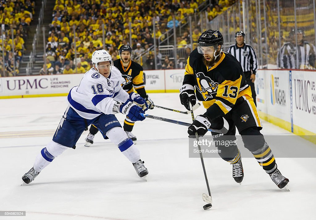Ondrej Palat #18 of the Tampa Bay Lightning reaches against <a gi-track='captionPersonalityLinkClicked' href=/galleries/search?phrase=Nick+Bonino&family=editorial&specificpeople=5805660 ng-click='$event.stopPropagation()'>Nick Bonino</a> #13 of the Pittsburgh Penguins during the second period of Game Seven of the Eastern Conference Finals in the 2016 NHL Stanley Cup Playoffs at the Consol Energy Center on May 26, 2016 in Pittsburgh, Pennsylvania.