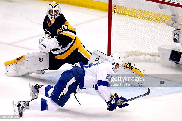 Ondrej Palat of the Tampa Bay Lightning scores a goal against Matt Murray of the Pittsburgh Penguins during the second period in Game One of the...