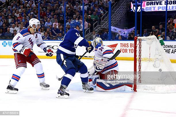 Ondrej Palat of the Tampa Bay Lightning scores a goal in the second period against Henrik Lundqvist of the New York Rangers during Game Three of the...