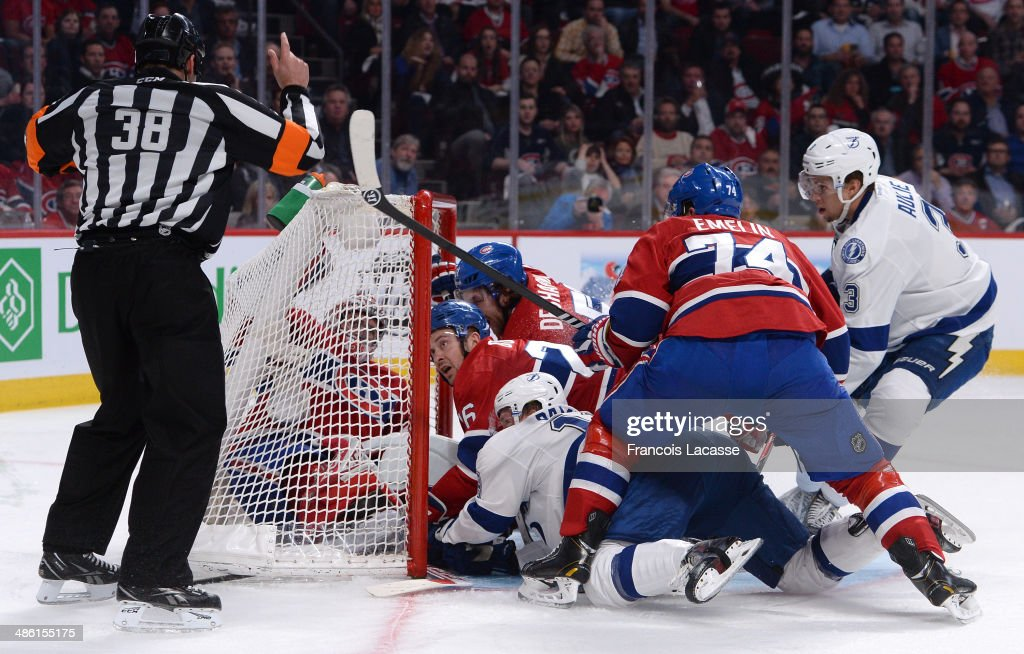 Ondrej Palat #18 of the Tampa Bay Lightning scores a goal on goaltender <a gi-track='captionPersonalityLinkClicked' href=/galleries/search?phrase=Carey+Price&family=editorial&specificpeople=2222083 ng-click='$event.stopPropagation()'>Carey Price</a> #31 of the Montreal Canadiens defended by <a gi-track='captionPersonalityLinkClicked' href=/galleries/search?phrase=Josh+Gorges&family=editorial&specificpeople=550446 ng-click='$event.stopPropagation()'>Josh Gorges</a> #26, <a gi-track='captionPersonalityLinkClicked' href=/galleries/search?phrase=David+Desharnais&family=editorial&specificpeople=4084305 ng-click='$event.stopPropagation()'>David Desharnais</a> #51 and <a gi-track='captionPersonalityLinkClicked' href=/galleries/search?phrase=Alexei+Emelin&family=editorial&specificpeople=723573 ng-click='$event.stopPropagation()'>Alexei Emelin</a> #74 in Game Four of the First Round of the 2014 Stanley Cup Playoffs on April 22, 2014 at the Bell Centre in Montreal, Quebec, Canada.