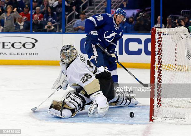 Ondrej Palat of the Tampa Bay Lightning scores past MarcAndre Fleury of the Pittsburgh Penguins during the second period at the Amalie Arena on...
