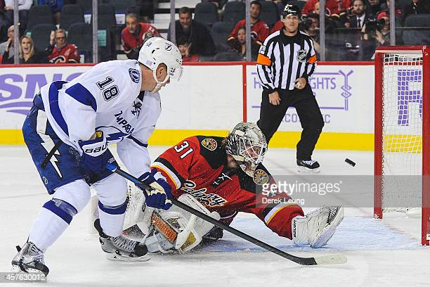 Ondrej Palat of the Tampa Bay Lightning scores the overtime game winning goal against Karri Ramo of the Calgary Flames during an NHL game at...