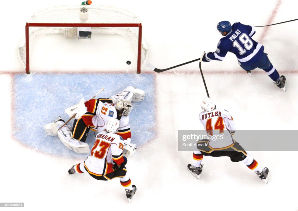 Ondrej Palat #18 of the Tampa Bay Lightning shoots the puck by goalie <a gi-track='captionPersonalityLinkClicked' href=/galleries/search?phrase=Karri+Ramo&family=editorial&specificpeople=716721 ng-click='$event.stopPropagation()'>Karri Ramo</a> #31 of the Calgary Flames for a goal during the second period at the Tampa Bay Times Forum on April 3, 2014 in Tampa, Florida.