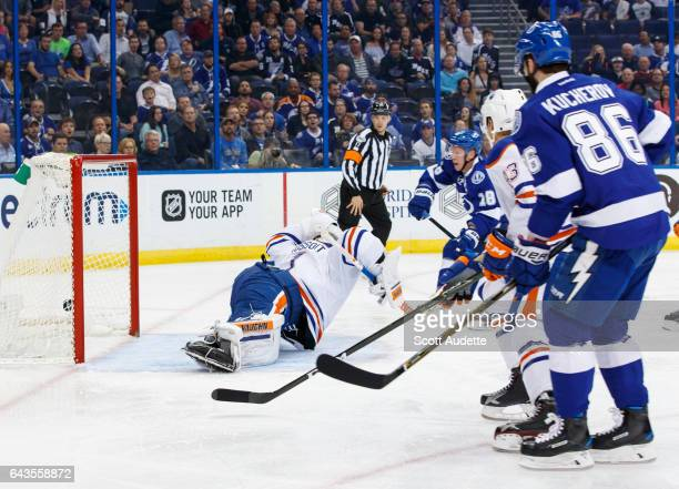 Ondrej Palat of the Tampa Bay Lightning shoots the puck for a goal against goalie Laurent Brossoit of the Edmonton Oilers during the first period at...