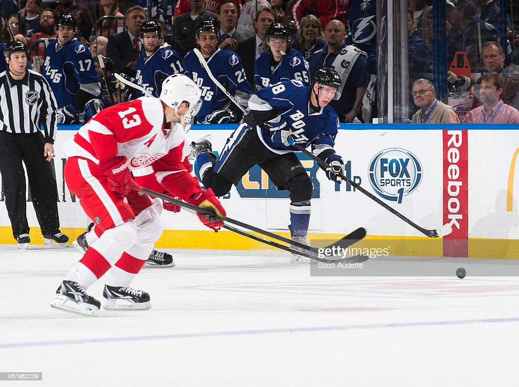 Ondrej Palat #18 of the Tampa Bay Lightning shoots the puck into the empty net to secure the win against the Detroit Red Wings during the third period at the Tampa Bay Times Forum on February 8, 2014 in Tampa, Florida.