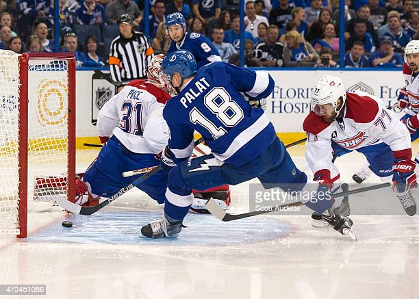 Ondrej Palat of the Tampa Bay Lightning shoots the puck into the net of goalie Carey Price of the Montreal Canadiens during the third period in Game...