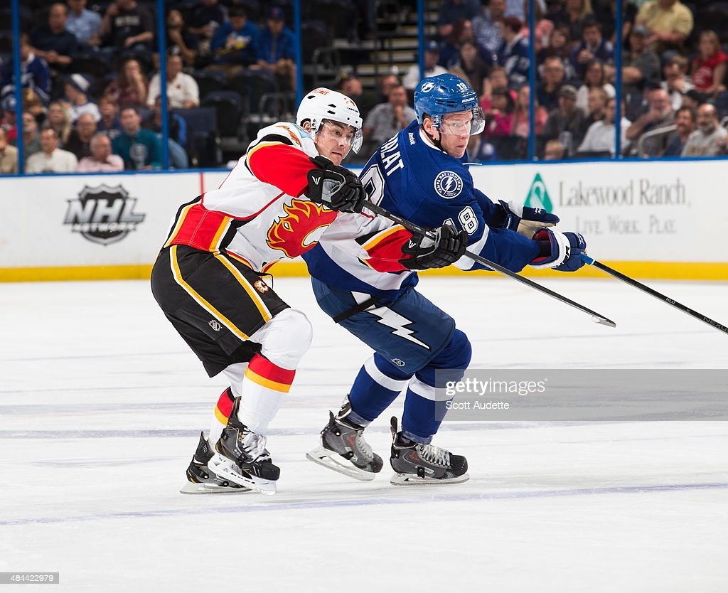 Ondrej Palat #18 of the Tampa Bay Lightning skates against <a gi-track='captionPersonalityLinkClicked' href=/galleries/search?phrase=Jiri+Hudler&family=editorial&specificpeople=2118675 ng-click='$event.stopPropagation()'>Jiri Hudler</a> #24 of the Calgary Flames during the first period at the Tampa Bay Times Forum on April 3, 2014 in Tampa, Florida.