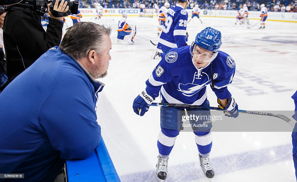 Ondrej Palat #18 of the Tampa Bay Lightning talks to Assistant Equipment Manager Rob Kennedy during the pregame warm ups against the New York Islanders before Game Two of the Eastern Conference Second Round in the 2016 NHL Stanley Cup Playoffs at the Amalie Arena on April 30, 2016 in Tampa, Florida.