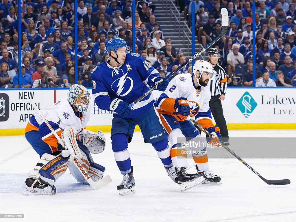 Ondrej Palat #18 of the Tampa Bay Lightning trips <a gi-track='captionPersonalityLinkClicked' href=/galleries/search?phrase=Nick+Leddy&family=editorial&specificpeople=5894600 ng-click='$event.stopPropagation()'>Nick Leddy</a> #2 of the New York Islanders in front of goalie <a gi-track='captionPersonalityLinkClicked' href=/galleries/search?phrase=Thomas+Greiss&family=editorial&specificpeople=695275 ng-click='$event.stopPropagation()'>Thomas Greiss</a> #1 during the first period of Game Two of the Eastern Conference Second Round in the 2016 NHL Stanley Cup Playoffs at the Amalie Arena on April 30, 2016 in Tampa, Florida.