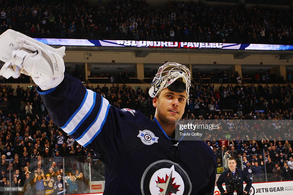Ondrej Pavalec #31 of the Winnipeg Jets salutes the fans after being named the first star of th game following a 2-1 defeat over the Boston Bruins at the MTS Centre on December 6, 2011 in Winnipeg, Manitoba, Canada.