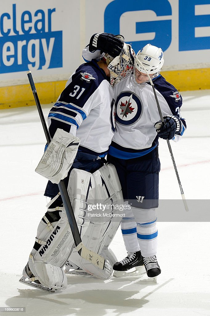 Ondrej Pavelec #31 celebrates with <a gi-track='captionPersonalityLinkClicked' href=/galleries/search?phrase=Tobias+Enstrom&family=editorial&specificpeople=2538468 ng-click='$event.stopPropagation()'>Tobias Enstrom</a> #39 of the Winnipeg Jets after defeating the Washington Capitals 4-2 at Verizon Center on January 22, 2013 in Washington, DC.
