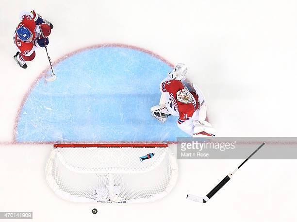 Ondrej Pavelec of Czech Republic loses his stick as a puck flies by in the third period against Slovakia during the Men's Qualification Playoff Game...