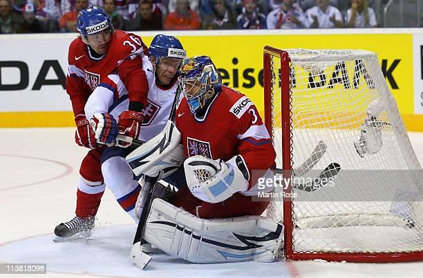 Ondrej Pavelec of Czech Republic saves the shot of Brank Radivojevic of Slovaki during the IIHF World Championship qualification match between Czech...