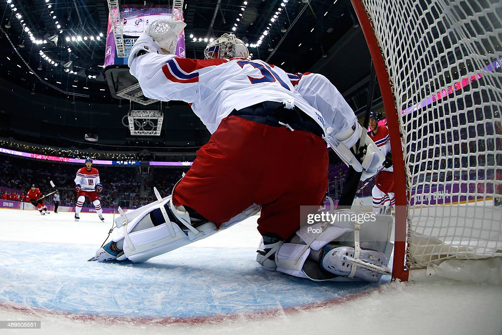 Ondrej Pavelec #31 of the Czech Republic gives up a goal to Simon Bodenmann #23 of Switzerland in the first period during the Men's Ice Hockey Preliminary Round Group C game on day eight of the Sochi 2014 Winter Olympics at Bolshoy Ice Dome on February 15, 2014 in Sochi, Russia.