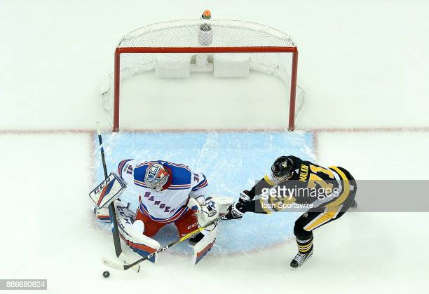 Ondrej Pavelec of the New York Rangers makes a save on a shot by Evgeni Malkin of the Pittsburgh Penguins in the third period during the game at PPG...