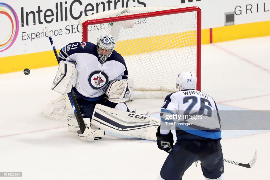 Ondrej Pavelec #31 of the Winnipeg Jets blocks a shot on goal against the Dallas Stars in the third period at American Airlines Center on February 2, 2017 in Dallas, Texas.
