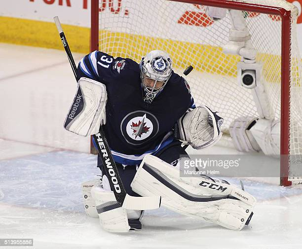 Ondrej Pavelec of the Winnipeg Jets blocks a shot on goal in first period action in an NHL game against the Montreal Canadiens at the MTS Centre on...