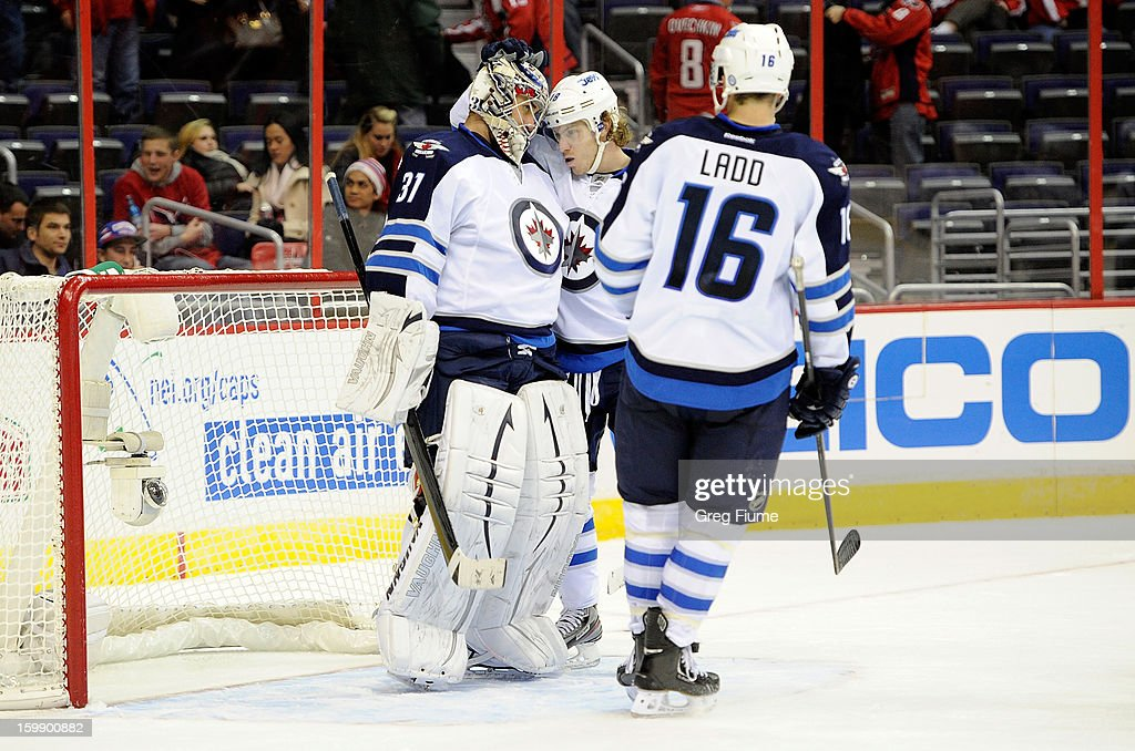 Ondrej Pavelec #31 of the Winnipeg Jets celebrates with <a gi-track='captionPersonalityLinkClicked' href=/galleries/search?phrase=Bryan+Little&family=editorial&specificpeople=540533 ng-click='$event.stopPropagation()'>Bryan Little</a> #18 and <a gi-track='captionPersonalityLinkClicked' href=/galleries/search?phrase=Andrew+Ladd&family=editorial&specificpeople=228452 ng-click='$event.stopPropagation()'>Andrew Ladd</a> #16 after a 4-2 victory against the Washington Capitals at the the Verizon Center on January 22, 2013 in Washington, DC.