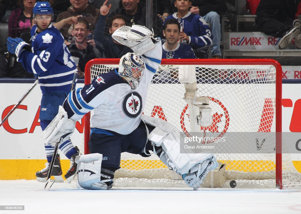 Ondrej Pavelec #31 of the Winnipeg Jets is beaten by a shot by Joffrey Lupul #19 of the Toronto Maple Leafs in a game on March 16, 2013 at the Air Canada Centre in Toronto, Ontario, Canada. The Jets defeated the Leafs 5-4 in an overtime shoot-out.