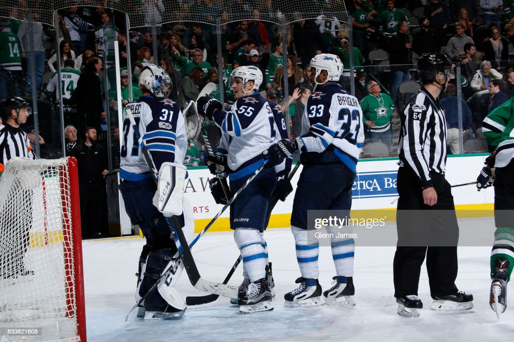 Ondrej Pavelec #31 of the Winnipeg Jets is congratulated by his teammates on a win against the Dallas Stars at the American Airlines Center on February 2, 2017 in Dallas, Texas.