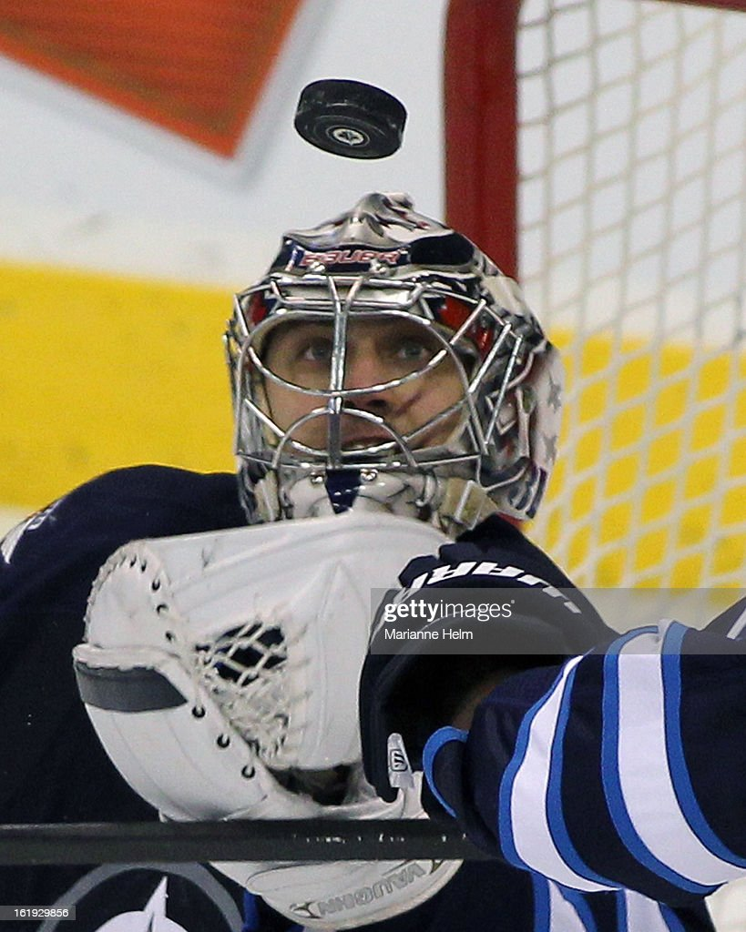Ondrej Pavelec #31 of the Winnipeg Jets keeps his eye on the puck during a game against the Boston Bruins during third period action on February 17, 2013 at the MTS Centre in Winnipeg, Manitoba, Canada.