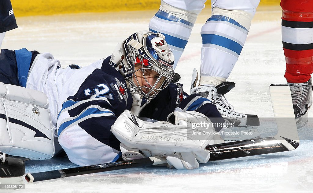 Ondrej Pavelec #31 of the Winnipeg Jets lies on the ice after making a save, during an NHL game against the Ottawa Senators, at Scotiabank Place, on March 17, 2013 in Ottawa, Ontario, Canada.