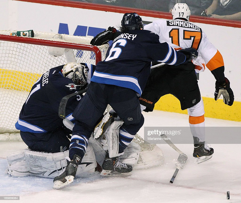 Ondrej Pavelec #31 of the Winnipeg Jets loses his stick as teammate <a gi-track='captionPersonalityLinkClicked' href=/galleries/search?phrase=Ron+Hainsey&family=editorial&specificpeople=206345 ng-click='$event.stopPropagation()'>Ron Hainsey</a> #6 shoves <a gi-track='captionPersonalityLinkClicked' href=/galleries/search?phrase=Wayne+Simmonds&family=editorial&specificpeople=4212617 ng-click='$event.stopPropagation()'>Wayne Simmonds</a> #17 of the Philadelphia Flyers past the goal during third period in a game between the Winnipeg Jets and the Philadelphia Flyers on April 6, 2013 at the MTS Centre in Winnipeg, Manitoba, Canada.
