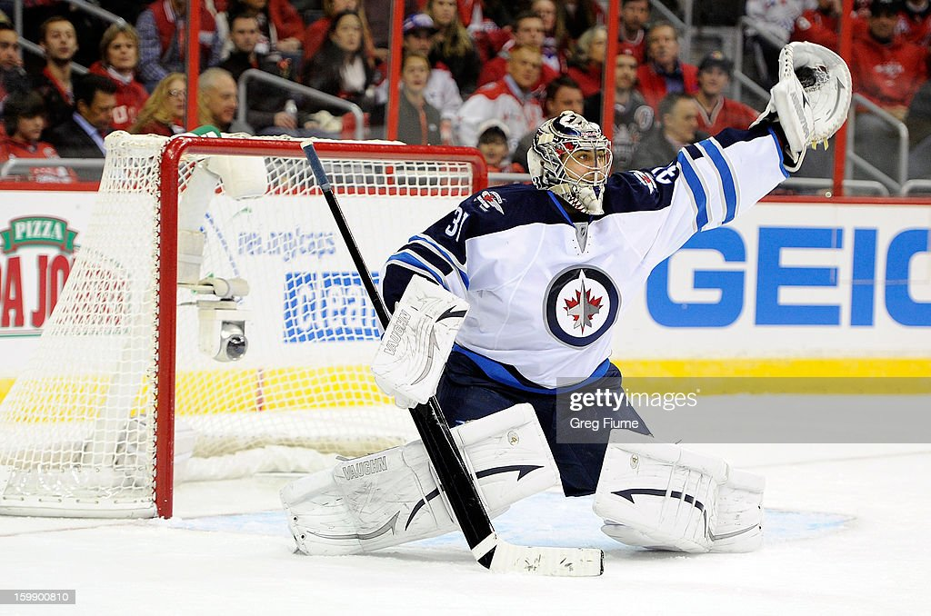 Ondrej Pavelec #31 of the Winnipeg Jets makes a save against the Washington Capitals at the the Verizon Center on January 22, 2013 in Washington, DC. Winnipeg won the game 4-2.