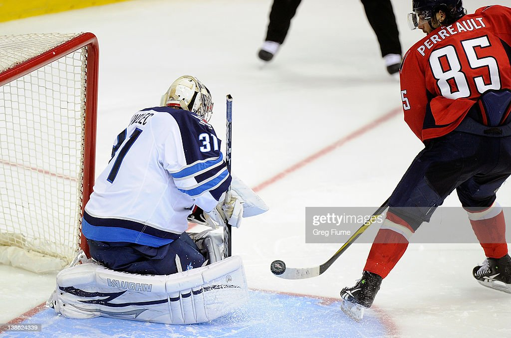 Ondrej Pavelec #31 of the Winnipeg Jets makes a save during the shootout against <a gi-track='captionPersonalityLinkClicked' href=/galleries/search?phrase=Mathieu+Perreault&family=editorial&specificpeople=776813 ng-click='$event.stopPropagation()'>Mathieu Perreault</a> #85 of the Washington Capitals at the Verizon Center on February 9, 2012 in Washington, DC. Winnipeg won the game 3-2 in a shootout.