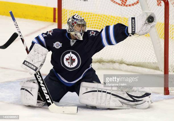 Ondrej Pavelec of the Winnipeg Jets makes a save in a game against the Edmonton Oilers in NHL action at the MTS Centre on February 27 2012 in...