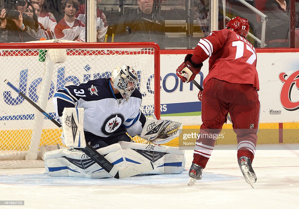 Ondrej Pavelec #31 of the Winnipeg Jets makes a save on a shootout attempt by <a gi-track='captionPersonalityLinkClicked' href=/galleries/search?phrase=Radim+Vrbata&family=editorial&specificpeople=204716 ng-click='$event.stopPropagation()'>Radim Vrbata</a> #17 of the Phoenix Coyotes at Jobing.com Arena on April 1, 2014 in Glendale, Arizona.
