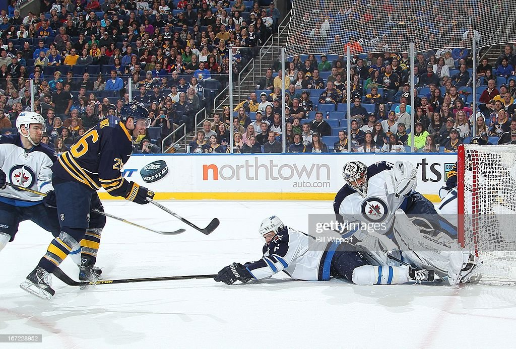 Ondrej Pavelec #31 of the Winnipeg Jets makes a third period glove save on <a gi-track='captionPersonalityLinkClicked' href=/galleries/search?phrase=Thomas+Vanek&family=editorial&specificpeople=570606 ng-click='$event.stopPropagation()'>Thomas Vanek</a> #26 of the Buffalo Sabres as <a gi-track='captionPersonalityLinkClicked' href=/galleries/search?phrase=Ron+Hainsey&family=editorial&specificpeople=206345 ng-click='$event.stopPropagation()'>Ron Hainsey</a> #6 slides past on April 22, 2013 at the First Niagara Center in Buffalo, New York. Winnipeg defeated Buffalo, 2-1.