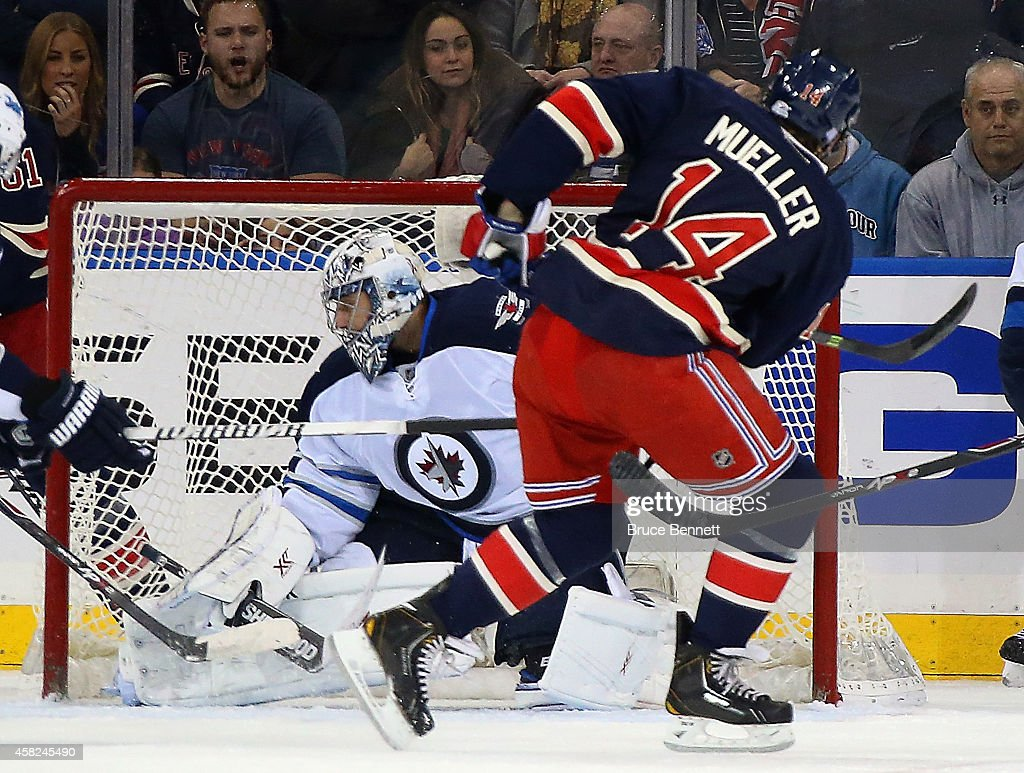 Ondrej Pavelec of the Winnipeg Jets makes the first period save on Chris Mueller of the New York Rangers at Madison Square Garden on November 1 2014...