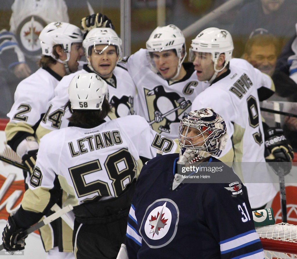 Ondrej Pavelec #31 of the Winnipeg Jets reacts after a goal by <a gi-track='captionPersonalityLinkClicked' href=/galleries/search?phrase=Sidney+Crosby&family=editorial&specificpeople=212781 ng-click='$event.stopPropagation()'>Sidney Crosby</a> #87 of the Pittsburgh Penguins during first-period action on January 25, 2013 at the MTS Centre in Winnipeg, Manitoba, Canada.