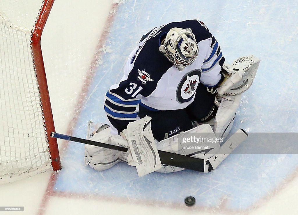 <a gi-track='captionPersonalityLinkClicked' href=/galleries/search?phrase=Ondrej+Pavelec&family=editorial&specificpeople=3644118 ng-click='$event.stopPropagation()'>Ondrej Pavelec</a> #31 of the Winnipeg Jets skates against the New York Islanders at the Nassau Veterans Memorial Coliseum on April 2, 2013 in Uniondale, New York. The Islanders defeated the Jets 5-2.