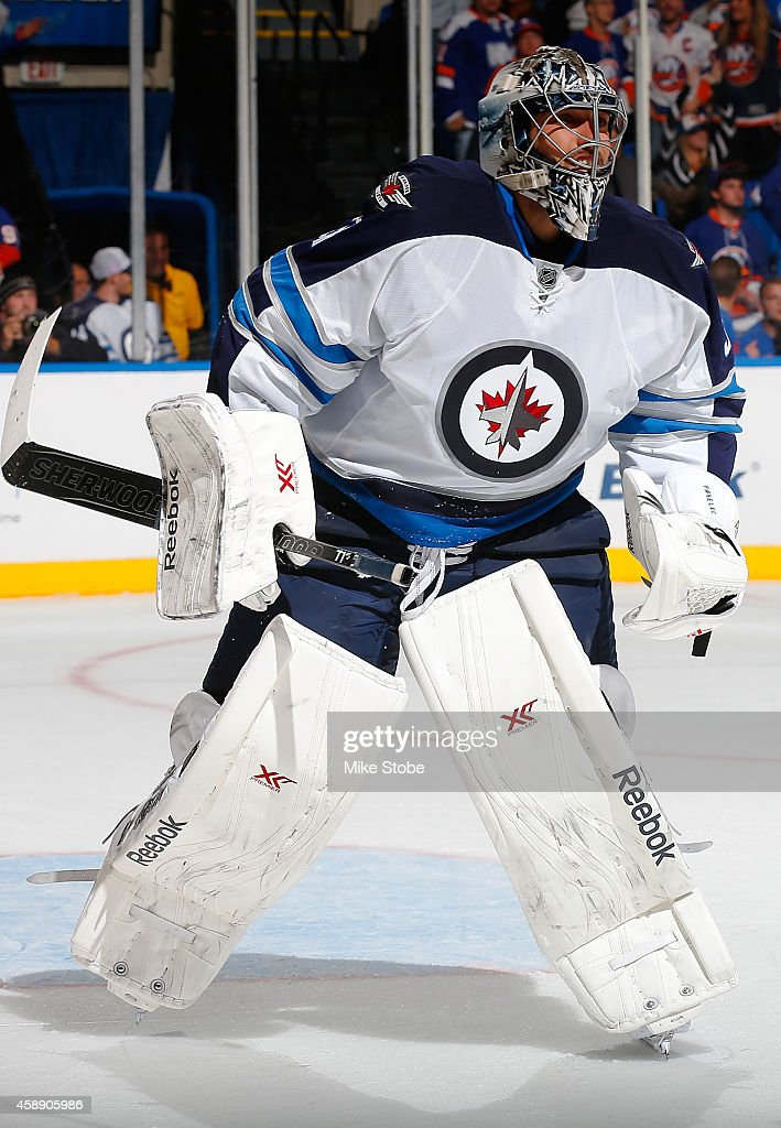 Ondrej Pavelec #31 of the Winnipeg Jets skates against the New York Islanders at Nassau Veterans Memorial Coliseum on October 28, 2014 in Uniondale, New York. The Winnipeg Jets defeated the New York Islanders 4-3.