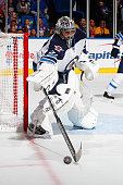 Ondrej Pavelec of the Winnipeg Jets skates against the New York Islanders at Nassau Veterans Memorial Coliseum on October 28 2014 in Uniondale New...