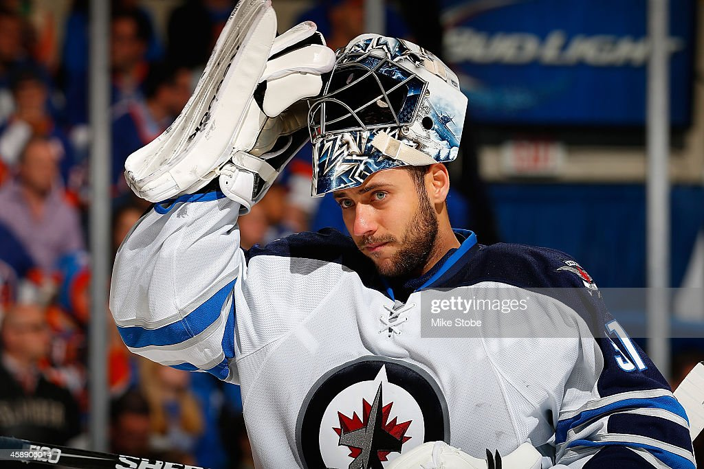 <a gi-track='captionPersonalityLinkClicked' href=/galleries/search?phrase=Ondrej+Pavelec&family=editorial&specificpeople=3644118 ng-click='$event.stopPropagation()'>Ondrej Pavelec</a> #31 of the Winnipeg Jets skates against the New York Islanders at Nassau Veterans Memorial Coliseum on October 28, 2014 in Uniondale, New York. The Winnipeg Jets defeated the New York Islanders 4-3.
