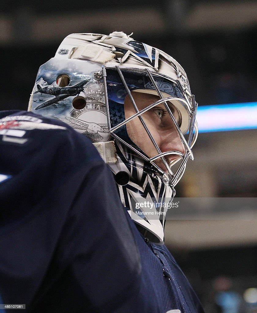 Ondrej Pavelec #31 of the Winnipeg Jets skates down the ice during warmup before an NHL game against the Boston Bruins at the MTS Centre on April 10, 2014 in Winnipeg, Manitoba, Canada.