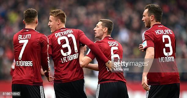 Ondrej Petrak of Nuernberg celebrates with teammates after scoring his team's first goal during the Second Bundesliga match between 1 FC Nuernberg...