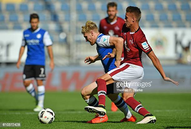 Ondrej Petrak of Nuernberg tackles Andreas Voglsammer of Bielefeld during the Second Bundesliga match between DSC Arminia Bielefeld and 1 FC...
